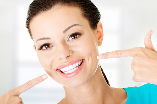 """Cosmetic dentistry has changed the way we look at our teeth. Gone are the days of """"ruining"""" our white smiles with ugly fillings, metal braces, and other important fixes. Now, anyone can have strong, white, healthy teeth without obvious repairs. An easy first step? Opting for attractive composite fillings. Sumerian text from 5,000 BC documented """"tooth worms"""" as the cause of oral decay. Before that, in 6,500 BC, tooth fillings were fashioned out of beeswax. It was until 1819 that amalgam fillings came into play, and they've proved effective ever since. But today, dental patients are fortunate to have a more appealing choice. Dentistry is constantly adjusting and evolving. When materials outlive their usefulness or show signs of creating health issues, they're replaced by stronger, safer, and more-effective materials. What are amalgam fillings anyway? Amalgams, the traditional metal fillings used for over a century, were developed in response to the need for a long-lasting and effective decay deterrent. Silvery amalgams contain an assortment of metals, including zinc, copper, nickel, tin, and even gold. Mercury, however, is the ingredient, often supplying more than 50 percent of the metal used per filling. Herein lies the problem. While mercury is considered the second-most toxic element after plutonium, the formulation used in dental offices is far less toxic, according to scientific research and the ADA. Despite a reduced level of toxicity, the metal in amalgam fillings can break down and release toxins that cause allergic reactions or health issues. And, while patients are encouraged to replace their amalgam fillings every 10 years or so, many stand by the notion that their fillings are good for a lifetime. Even if you do get lucky with amalgam fillings that are structurally sound beyond their average 12-year life span, you can't be sure that they're not leaking dangerous toxins. Is it really worth the risk? White, tooth-colored fillings are a far better option Toot"""